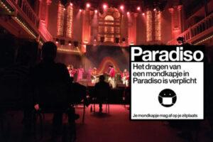 'Met mondkapje en langs rode tape door Paradiso'